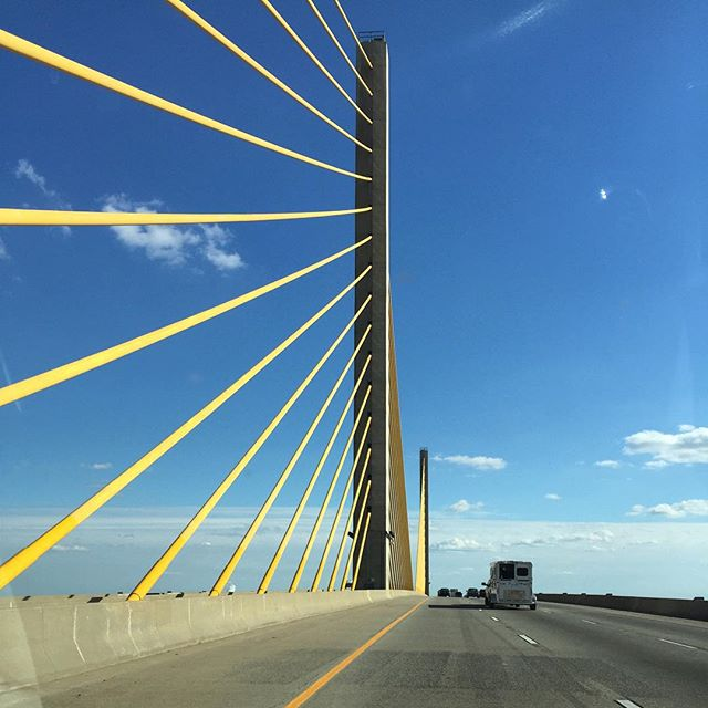 The Chesapeake & Delaware Canal Bridge is gorgeous against a deep blue sky.