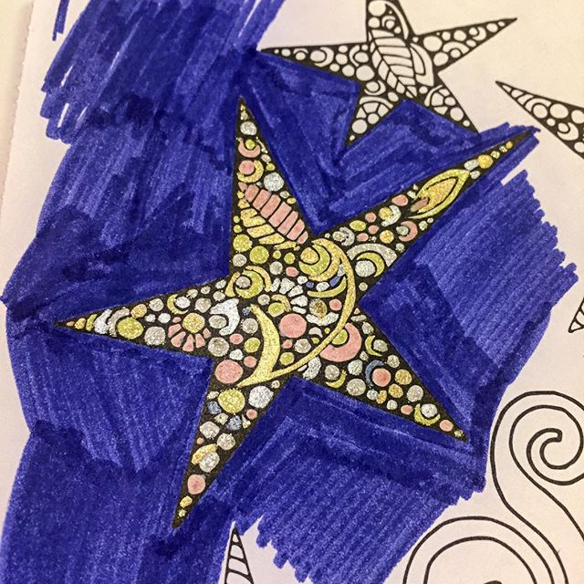 Coloring with glitter and metallic gel pens to clear the mind.