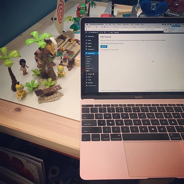 Using my son's room as a quiet spot for a meeting so now my workspace includes a Moana+Minions Lego mashup.