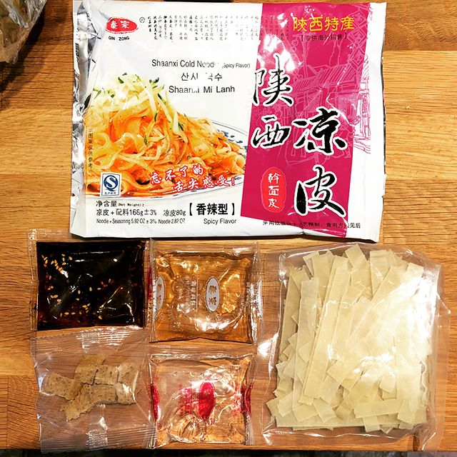 "Trying a liangpi (""cold skin"") noodle pack today, looks promising. It's kinda like a super upgraded cup noodle - steep, rinse, drain, mix, done."