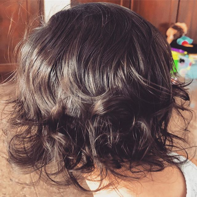 Very upset with baby girl for naturally having the kind of bouncy curls I paid $300 to have put in my hair.