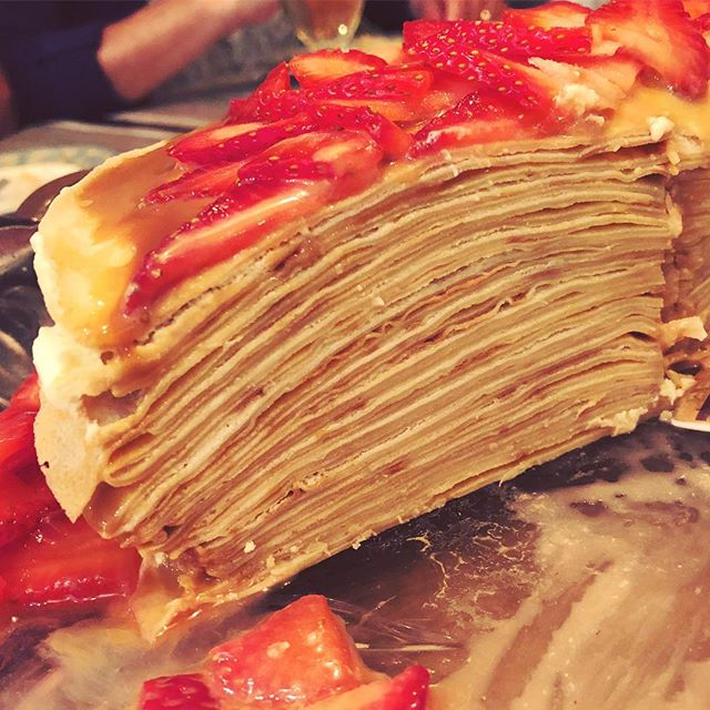 Mille crêpe cake with dulce de leche, whipped cream, and strawberries - a ton of work but worth it!