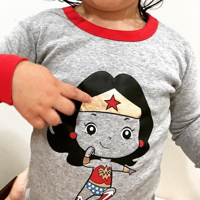 Baby girl pointed at the Wonder Woman on her new PJs and said her own name because she knows what's up