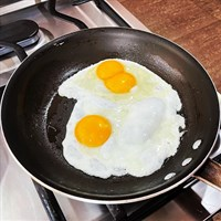 an egg on top of a pan on a table